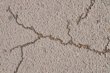 Asphalt road with crack after rain