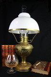 Antique Paraffin Lamp and Leather Books poster
