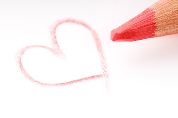 pencil writing on white paper - heart
