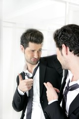 Handsome man humor funny gesture in a mirror
