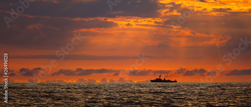 Navy ship on sunset