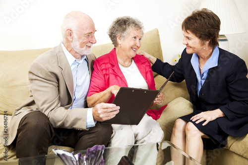 Senior Couple and Saleswoman