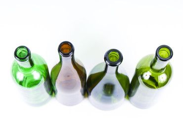 Four colored bottles on a white background.