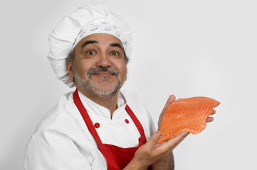smiling chef with fresh salmon