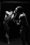 Fototapety MMA - Mixed martial artists fighting - kicking