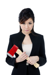 Attractive businesswoman carrying an axe