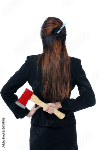Businesswoman holding axe behind her back