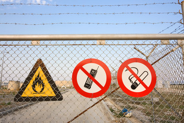Fence with warning signs
