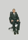 man sitting in office chair