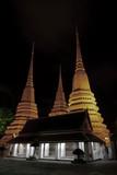 Chedis of the four kings at Wat Pho, Bangkok, Thailand poster
