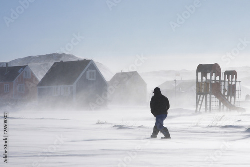 Keuken foto achterwand Antarctica 2 Inuit man walking home in a winter storm, Greenland