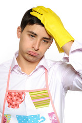 Expressions. Tired man in apron and yellow glove for washing dis