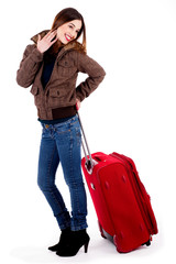 young lady posing with luggage