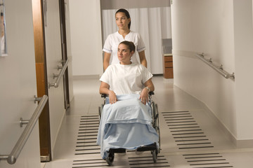 Nurse and beautiful patient on the wheelchair