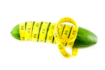 Measure with cucumber on a white background