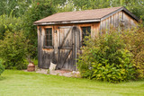 A charming, rustic garden shed made from reclaimed timber