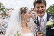 Bride and Groom in confetti shower