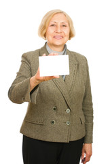 Portrait of a happy senior woman with blank sigh on white