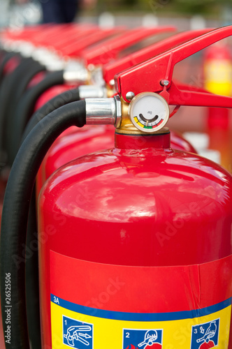 Group of ready fire extinguishers for use