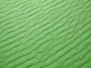 Abstract background of green sand ripples at the beach