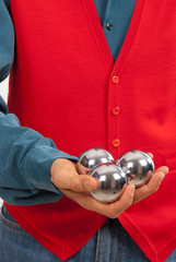 Practicing hand dexterity with three metal balls
