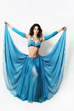 Beautiful oriental cabaret woman in blue wide dress