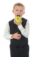 Boy eats an apple
