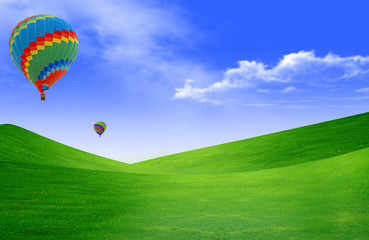 Hot air baloon floating in the sky over land