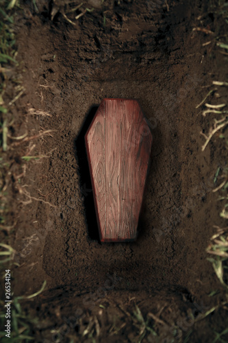 Leinwandbild Motiv coffin or tomb at graveyard
