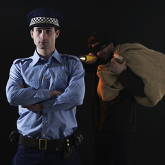 Policeman and thief. Robbery scene.