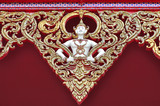 Sculpture of sprite on temple roof poster