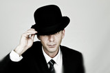 Businessman wearing bowler hat