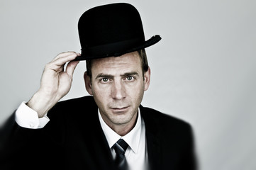 Businessman Holding a Bowler Hat