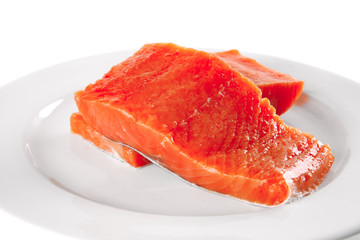 fresh smoked salmon on white plate
