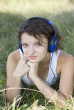 young girl listens to music