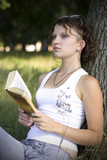 girls  reading book outdoors