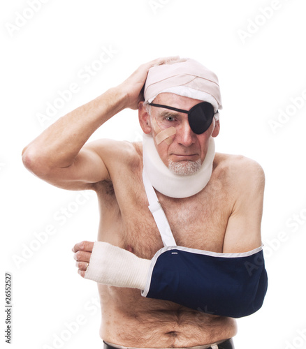 Old man with multiple injuries bandaged
