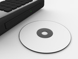 A render of a compact disc and a laptop disc tray
