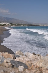 Puerto Banus beach from stone pier