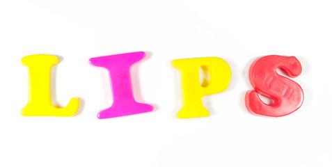 lips written in fridge magnets