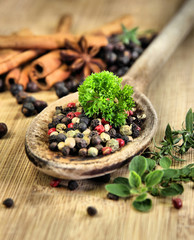 Spice mix on wooden background