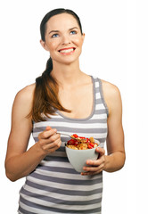 Beautiful young happy woman holding a healthy bowl of cereal wit