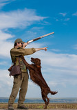 Hunter training the hunting dog during hunt