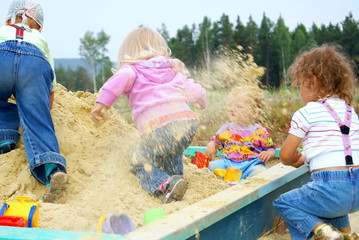 Children play to a sandbox
