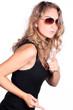 brünette beauty Frau mit Brille blickt cool