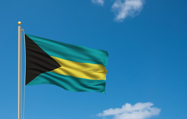 Flag of Bahamas waving in the wind in front of blue sky