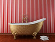 classic bathroom with old bathtub and red stripped wall