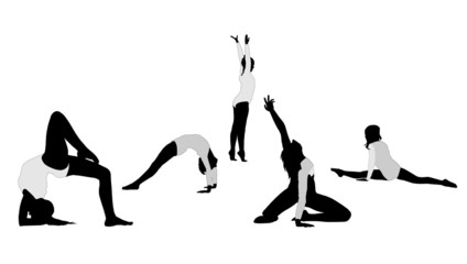 Young rhythmic gymnasts silhouette. Floor exercise.