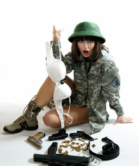 The sexy girl in the military form