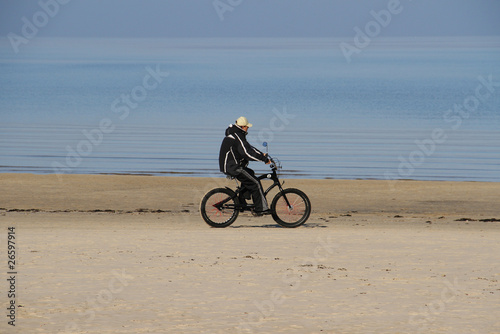 bicyclist on the seashore